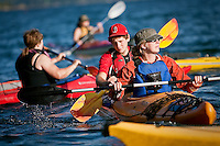 JEROME A. POLLOS/Press..Jessica Johanson, right, and Tyler Woodhouse, lead students in the Sea Kayak Quickstart clinic out on Lake Coeur d'Alene Tuesday from the Yap-Keehn-Um beach at North Idaho College. The class, put on by NIC's Outdoor Pursuits, is designed for beginners and highlights proper paddling and self-rescue techniques.