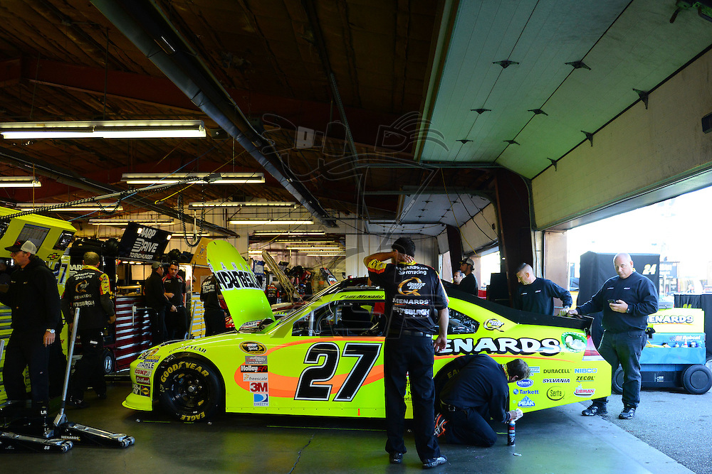 Brooklyn, MI  - Aug 18, 2012: Paul Menard (27) in the garage during practice for the Pure Michigan 400 at Michigan International Speedway in Brooklyn, MI.