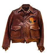 "This type A-2 flight jacket belonged to Leonard J. Otten, a pilot attached to the 571st Squadron of the 390th Bomb Group. On the front of the jacket is the 571st Squadron insignia patch, a wolf in uniform gripping a bomb. Above the patch is a name plate reading ""L.J. Otten"". There is no artwork on the back to identify to the aircraft Otten flew, or the amount of missions Otten participated in."