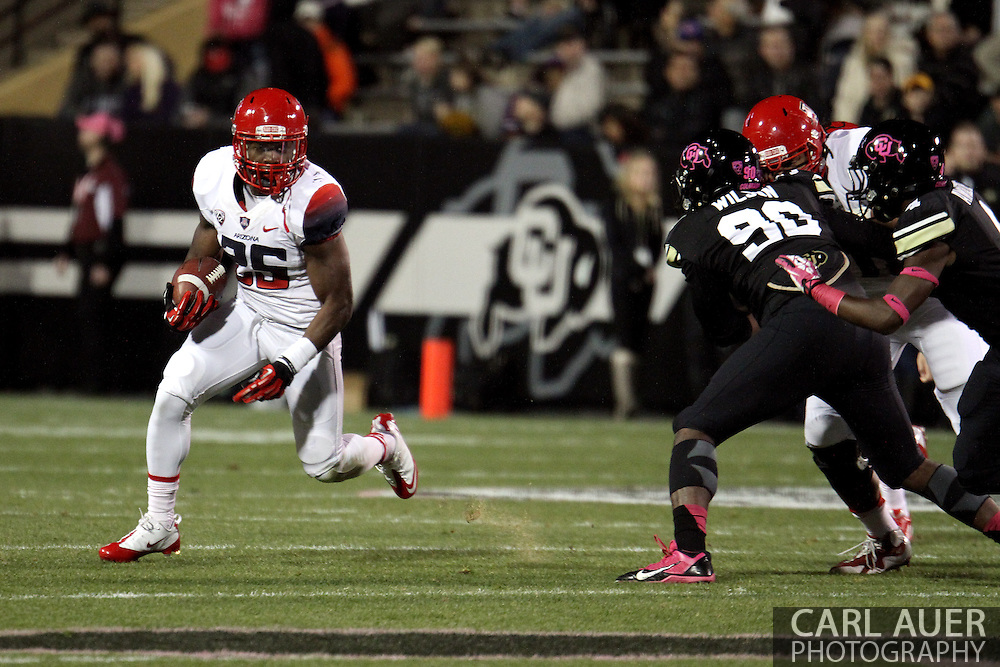 October 26th, 2013:  University of Arizona Wildcats junior running back Ka'Deem Carey (25) runs the ball in the first quarter of action in the NCAA football game between the University of Arizona Wildcats and the University of Colorado Buffaloes at Folsom Field in Boulder, Colorado