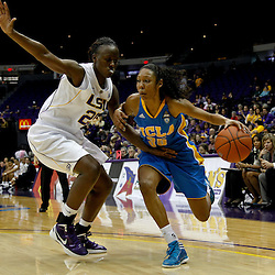 December 13, 2011; Baton Rouge, LA; UCLA Bruins guard Rebekah Gardner (35) drives past LSU Lady Tigers guard Destini Hughes (20)during the second half of a game at the Pete Maravich Assembly Center. LSU defeated UCLA 58-41. Mandatory Credit: Derick E. Hingle-US PRESSWIRE