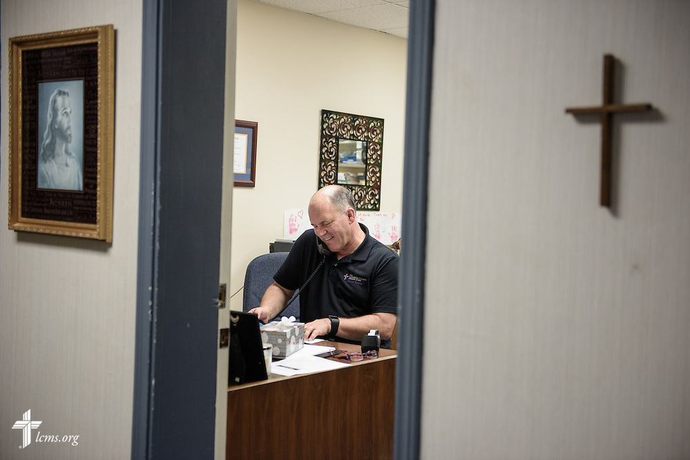The Rev. David Buss, senior pastor of Trinity Lutheran Church, Baton Rouge, La., makes calls to parishioners who were affected by the August flooding, in the church office on Tuesday, Sept. 13, 2016. LCMS Communications/Erik M. Lunsford