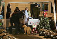 Pine Bush, NY - A group of people, including a woman and her dog, line up for hot chocolate at the snow falls during the Pine Bush Festival of Lights on Dec. 5, 2009.