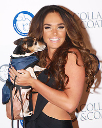 Tamara Ecclestone hugs Lilly Langtry, the 8 year old Jack Russell Terrier at  the Collars & Coats Gala ball, the Battersea Dogs Home, November 8, 2012. Photo by i-Images.