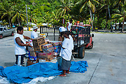 Locals unloading the cargo boat on Tau Island, Manuas, American Samoa, South Pacific