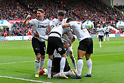 Goal - Tom Lawrence (10) of Derby County turns to the fans as punches the air as Jayden Bogle (37) of Derby County celebrates scoring a goal to give a 0-2 lead to the away team during the EFL Sky Bet Championship match between Bristol City and Derby County at Ashton Gate, Bristol, England on 27 April 2019.