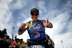 November 12, 2017 - Athens, Attica, Greece - A woman poses with her metal during the 35th Athens Classic Marathon in Athens, Greece, November 12, 2017. (Credit Image: © Giorgos Georgiou/NurPhoto via ZUMA Press)