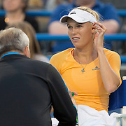 August 16, 2014, New Haven, CT:<br /> Caroline Wozniacki talks with her coach during a match against Timea Bacsinszky on day four of the 2014 Connecticut Open at the Yale University Tennis Center in New Haven, Connecticut Monday, August 18, 2014.<br /> (Photo by Billie Weiss/Connecticut Open)