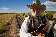 Cowboy singer Colonel Jim Garvey entertaining passengers on the Grand Canyon Railway train.