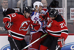 Oct 5, 2009; Newark, NJ, USA; New York Rangers defenseman Michal Rozsival (33) is hit by New Jersey Devils center David Clarkson (23) and New Jersey Devils right wing Jay Pandolfo (20) during the second period at the Prudential Center.