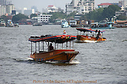 The Chao Phraya river is a major transportation artery for a vast network of river buses, cross-river ferries and water taxis, also known as longtails. More than 15 boat lines operate on the rivers and canals of the city, including commuter lines. Maenam (river) Chao Phraya, is a major river in Thailand, with its low alluvial plain forming the center of the country. It runs through Bangkok, the capital city, and then empties into the Gulf of Siam.
