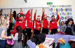 Luke Freeman, Max O'Leary, Jamie Paterson, Aden Flint and Richard O'Donnell of Bristol City sing christmas carols during Bristol City's visit to the Children's Hospice South West at Charlton Farm - Mandatory by-line: Robbie Stephenson/JMP - 21/12/2016 - FOOTBALL - Children's Hospice South West - Bristol , England - Bristol City Children's Hospice Visit
