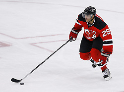 Jan 21, 2008; Newark, NJ, USA; New Jersey Devils defenseman Johnny Oduya (29) skates with the puck during the third period at the Prudential Center. The Devils defeated the Canadiens 5-2.