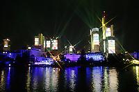 Feature Skyline Frankfurt a. M.          Zur Feier der Fussball-Weltmeisterschaft werden in Frankfurt am Main nachts ueberdimensionale Fotos der vergangenen Fussball-Weltmeisterschaften auf die Skyline der Stadt projeziert, untermalt mit Musik und Lichteffekten. Hier werden die Nationalflaggen der an der Fussball-Weltmeisterschaft teilnehmenden Nationen gezeigt.