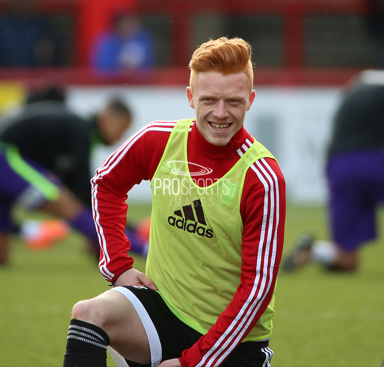 Brentford midfielder, Ryan Woods (15) warming up during the Sky Bet Championship match between Brentford and Charlton Athletic at Griffin Park, London, England on 5 March 2016. Photo by Matthew Redman.