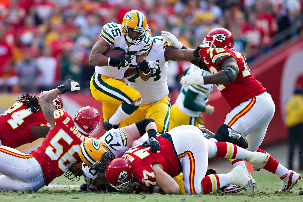 KANSAS CITY, MO - DECEMBER 18:  Ryan Grant #25 of the Green Bay Packers runs the ball against the Kansas City Chiefs at Arrowhead Stadium on December 18, 2011 in Kansas CIty, Missouri.  The Chiefs defeated the Packers 19-14.   (Photo by Wesley Hitt/Getty Images) *** Local Caption *** Ryan Grant