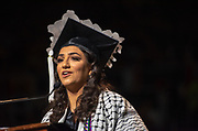 Amal Afyouni delivers the student address at undergraduate commencement. Photo by Ben Siegel