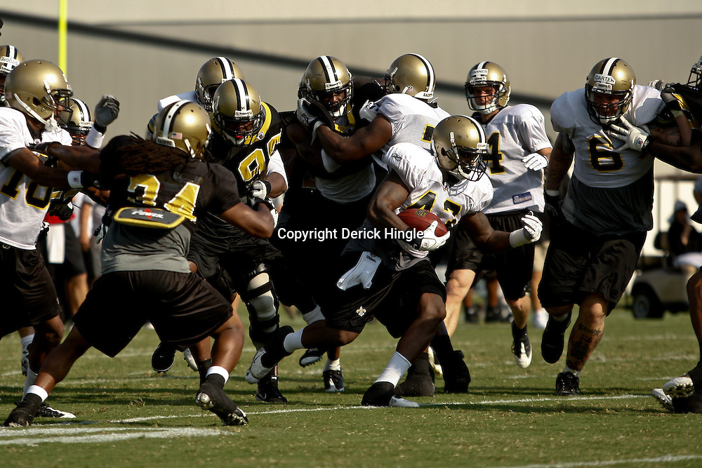 August 1, 2010; Metairie, LA, USA; New Orleans Saints running back P.J. Hill (43) runs through a hole in the defense during a training camp practice at the New Orleans Saints practice facility. Mandatory Credit: Derick E. Hingle