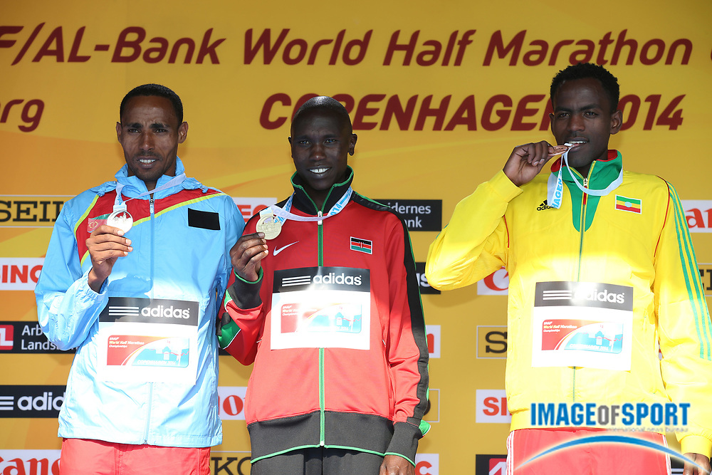 Mar 29, 2014; Copenhagen, Denmark; Gold medalist Geoffrey Kipsang Kamworor (KEN) poses with silver medalist Samuel Tsegay (ERI) and bronze medalist Guye Adola (ETH) at the IAAF/AL-Bank World Half Marathon Championship. Photo by Jiro Mochizuki