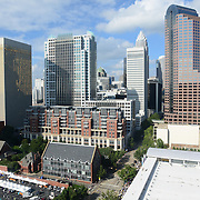 The Charlotte skyline towers over attendees lined up on the sidewalk to attend the 2012 Democratic National Convention