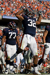 Virginia running back Keith Payne (32) celebrates after scoring a touchdown...The Virginia Cavaliers defeated the Connecticut Huskies 17-16 at Scott Stadium in Charlottesville, VA on October 13, 2007