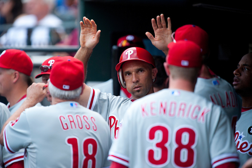 NEW YORK - JULY 16: Raul Ibanez #29 of the Philadelphia Phillies gets greeted in the dugout by his teammates after scoring arun during the game against the New York Mets at Citi Field on July 16, 2011 in the Queens borough of Manhattan. (Photo by Rob Tringali) *** Local Caption *** Raul Ibanez