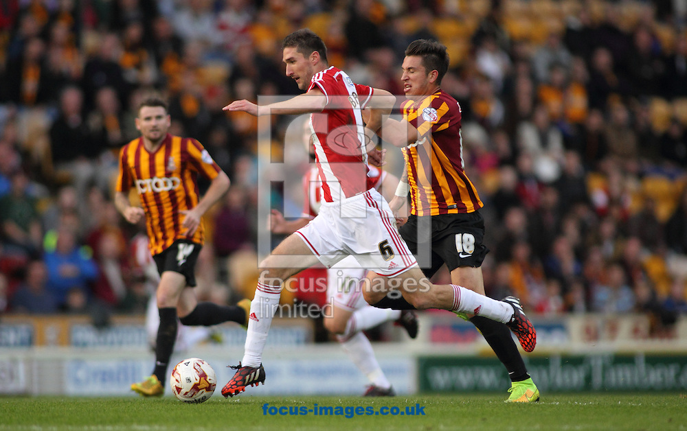 Christopher Routis (R) of Bradford City chases down the attack of Chris Basham (L)  of Sheffield United during the Sky Bet League 1 match at the Coral Windows Stadium, Bradford<br /> Picture by Stephen Gaunt/Focus Images Ltd +447904 833202<br /> 18/10/2014