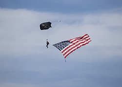 October 21, 2018 - Austin, USA - A skydiver trails an American flag before the start of the Formula 1 U.S. Grand Prix at the Circuit of the Americas in Austin, Texas on Sunday, Oct. 21, 2018. (Credit Image: © Scott Coleman/ZUMA Wire)
