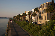 Sunrise over estate homes along the Battery in historic Charleston, SC overlooking Charleston harbor. The homes are considered the some of the best preserved historic homes in America.
