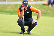Swedish golf professional Peter Hanson lines up his putt during the BMW PGA Championship at the Wentworth Club, Virginia Water, United Kingdom on 28 May 2016. Photo by Simon Davies.