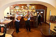 Guitar musicians in the bar of Hostal Conde de Villanueva, Havana, Cuba.