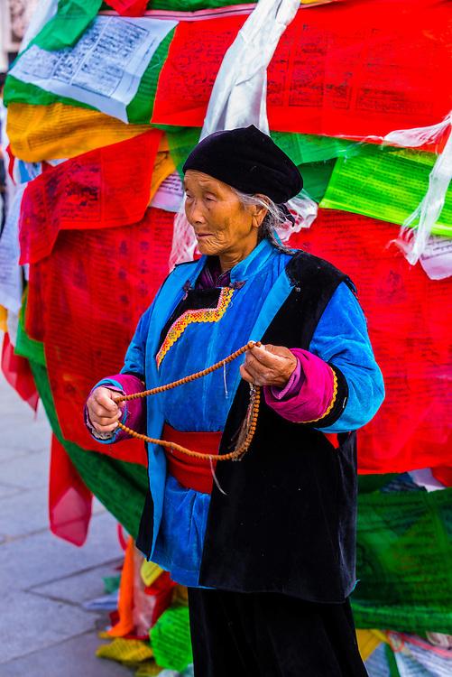 Tibetan pilgrim circumambulating Barkhor Square, Lhasa, Tibet, China.