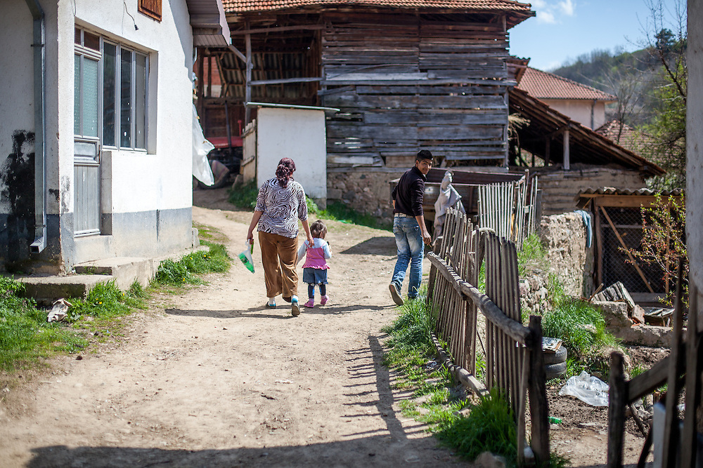 A family walking the streets of the city of Crnik, Macedonia.