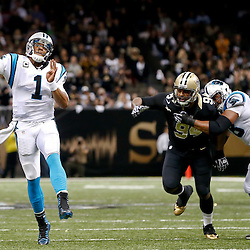 Dec 8, 2013; New Orleans, LA, USA; Carolina Panthers quarterback Cam Newton (1) is pressured to throw by New Orleans Saints defensive end Cameron Jordan (94) during the fourth quarter of a game at Mercedes-Benz Superdome. The Saints defeated the Panthers 31-13. Mandatory Credit: Derick E. Hingle-USA TODAY Sports