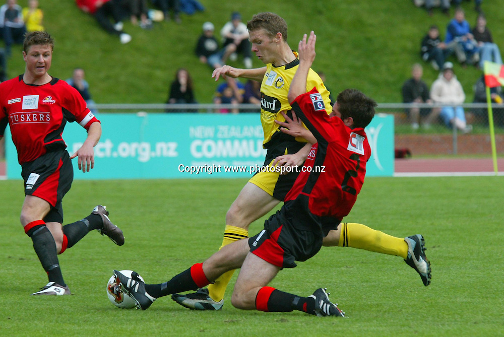 Canterbury's Daniel Terris tackles Wellington's Rupert Ryan during the 2 all draw on Newtown Park, Sunday afternoon. Soccer NZFC Round 1 17 October 2004.<br /> Photo: Marty Melville/Photosport