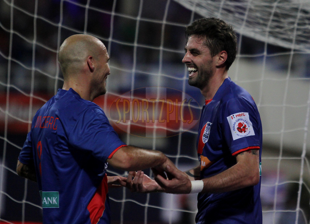 Fredrik Ljungberg of Mumbai City FC congratulates Andre Francisco Moritz of Mumbai City FC after he scored a goal during match 6 of the Hero Indian Super League between Mumbai City FC and FC Pune City held at the D.Y. Patil Stadium, Navi Mumbai, India on the 18th October 2014.<br /> <br /> Photo by:  Vipin Pawar/ ISL/ SPORTZPICS