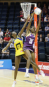 Sonia Mkoloma does her best to stop Aiken.  ANZ Netball Championship. Round 3 - Queensland Firebirds v Central Pulse. Played at Brisbane Convention Centre. Firebirds (56) defeated the Pulse (28).  Photo: Warren Keir (SMP/Photosport NZ).<br /> <br /> Use information: This image is intended for Editorial use only (e.g. news or commentary, print or electronic). Any commercial or promotional use requires additional clearance.
