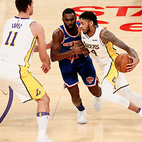 21 January 2018: Los Angeles Lakers forward Brandon Ingram (14) drives past New York Knicks forward Tim Hardaway Jr. (3) on a screen set by Los Angeles Lakers center Brook Lopez (11) during the LA Lakers 127-107 victory over the New York Knicks, at the Staples Center, Los Angeles, California, USA.