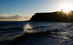 © Licensed to London News Pictures. 08/10/2012..North Bay, Scarborough, England..Waves are backlit by the morning sun as they break at North Bay in Scarborough, North Yorkshire...Photo credit : Ian Forsyth/LNP