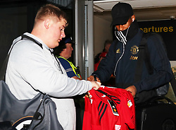 Marcus Rashford is spotted on his way to catch a flight as the team fly to Turin on Tuesday afternoon to play Juventus in The Champions League on Wednesday night.
