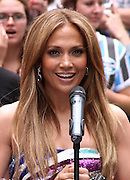 """Jennifer Lopez appears to unveil her """"Be Extraordinary"""" Poster in Times Square New York City on June 10, 2010."""