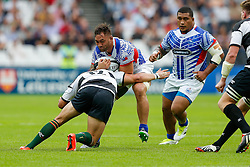 Samoa Flanker Jack Lam is tackled by Barbarians Inside Centre Wynand Olivier (Montpellier & South Africa) - Mandatory byline: Rogan Thomson/JMP - 07966 386802 - 29/08/2015 - RUGBY UNION - The Stadium at Queen Elizabeth Olympic Park - London, England - Barbarians v Samoa - International Friendly.
