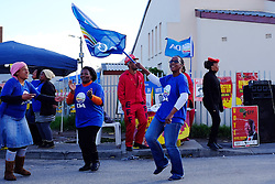 supporters of the Democratic Alliance ( DA ) celebrate as they seek voters to support their party in Masiphumelele near Fish Hoek, Cape Town during the 2016 local government elections held across South Africa on the 3rd August 2016<br /> <br /> Photo by - Ron Gaunt / RealTime Images