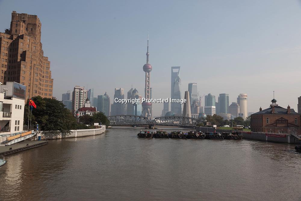 China, Shanghai. Pudong slyline and Waibadu bridge view from the Bund, Suzhou creek