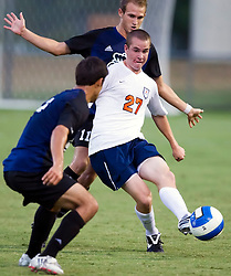 Virginia Cavaliers forward Brian Ownby (27) passes around two ODU players.  The Virginia Cavaliers defeated the Old Dominion Monarchs 3-0 in a pre-season NCAA Men's Soccer exhibition game held at Klockner Stadium on the Grounds of the University of Virginia in Charlottesville, VA on August 23, 2008.