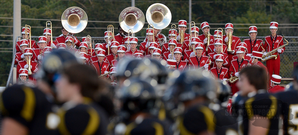 Photo by Gary Cosby Jr.   The Hartselle High Marching Band is visible above the Athens players during the Golden Eagles game with Hartselle Friday night in Athens.