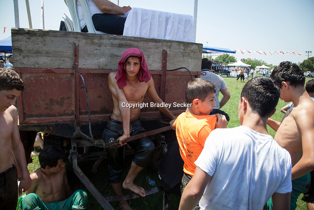 Younger wrestlers take a break between their matches at an oil wrestling tornament in Silivri, Turkey.
