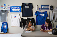 Providencia Santiago, left, and Aida Pacheco, volunteers with Organizing for America, President Obama's re-election campaign arm, talk in the group's Richmond headquarters on Thursday, May 3, 2012 in Richmond, VA.