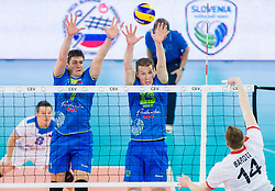 Matevz Kamnik #7 of Slovenia and Tine Urnaut #13 of Slovenia vs Arpad Baroti of Hungary  during qualifications match of FIVB Men's Volleyball World Championship 2014 between National teams of Slovenia and Israel in pool B on May 25, 2013 in Arena Stozice, Ljubljana, Slovenia. Slovenia defeated Hungary 3-0. (Photo By Vid Ponikvar / Sportida)