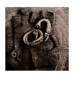 """Chained (001)"" (1989/2004) 5/50 (incomplete edition) £900* GBP. Image Size: 23cm x 23cm, Paper Size 30cm x 40cm, selenium toned silver gelatin lith print. Each silver gelatin print has been split-selenium toned using archival methods and is stamped, titled, signed on the reverse. Please email me at info@simon-larbalestier.co.uk for availability and shipping info. All prints are shipped from the United Kingdom. *Stated price does not include shipping."
